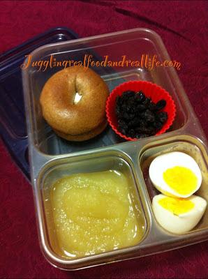 Mini Bagel with Cream Cheese, Raisins, Apple Sauce (no sugar added) and Hard Boiled Egg