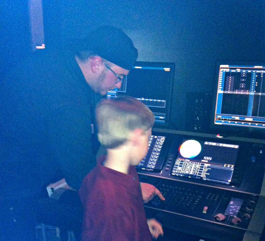 College boy teaching Lil C about the light board
